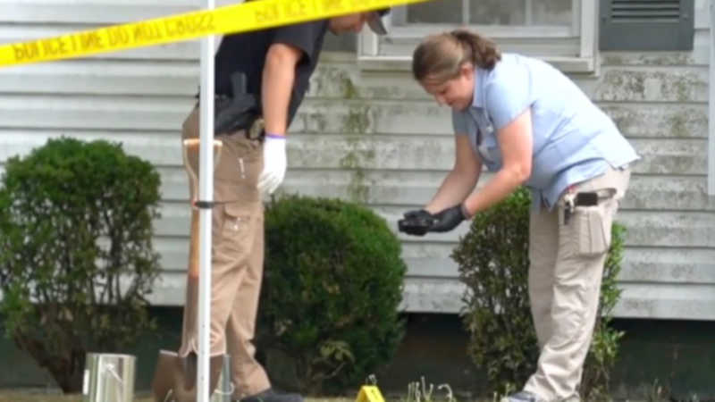dismembered body in driveway