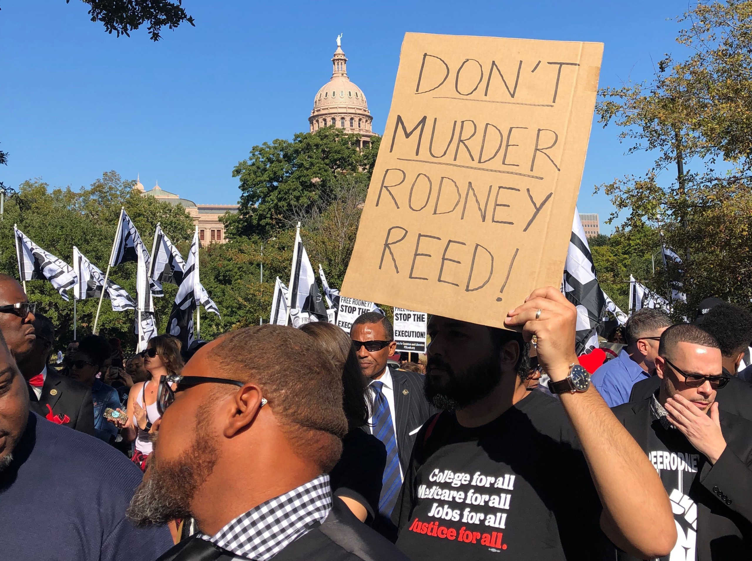 Rodney Reed protestors hold signs