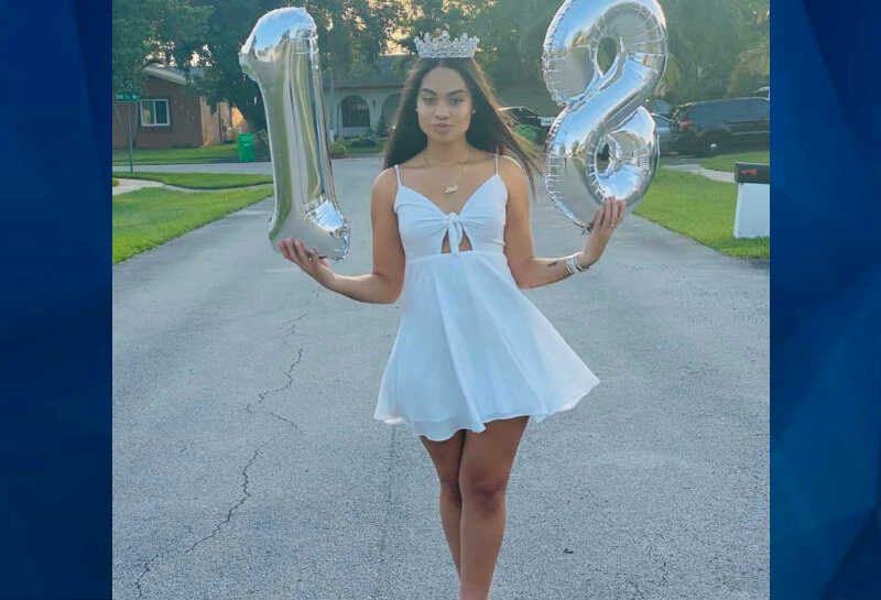 Miya Marcano holding balloons